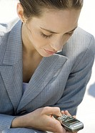 Businesswoman checking messages on cell phone