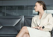 Female traveler sitting in airport lounge