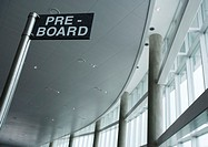 'Pre-board' sign in airport, low angle view