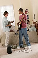 Teenagers playing guitars.