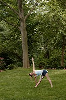 Woman doing yoga outside.