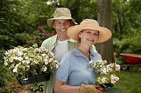 Couple gardening, portrait