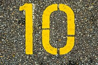 Singapore, Sentosa Island, yellow numbers on pavement of car park, '10'