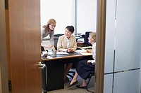 Three businesswomen talking in an office