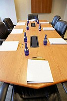 High angle view of water bottles and ring binder files on a conference table