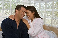 Close-up of a mid adult couple smiling in the bathroom