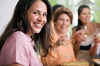 Portrait of a mature woman with her friends enjoying a party