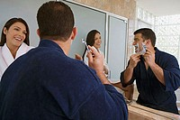 Close-up of a mid adult couple looking at each other in the bathroom