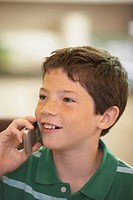 Close-up of a boy talking on a mobile phone