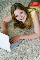 High angle view of a girl using a laptop