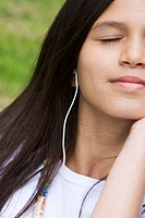 Close-up of a girl listening to music (thumbnail)