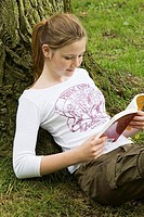 High angle view of a girl reading a book