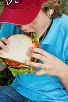 Close-up of a boy eating a sandwich