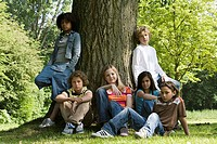 Portrait of a group of children resting in a park