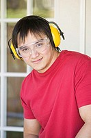 Portrait of a young man wearing protective workwear (thumbnail)