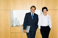 Portrait of a businessman standing with a businesswoman and smiling