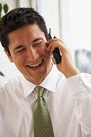 Close-up of a businessman talking on the phone