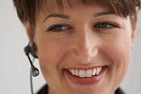 Close-up of a businesswoman using a hands free device