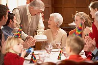 Grandmother getting her birthday cake at the table with family, Richmond, Virginia, United States