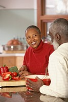 Senior African couple chopping vegetables, Richmond, Virginia, United States