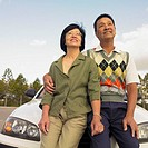 Senior Asian couple sitting on the hood of a car, Perth, Australia