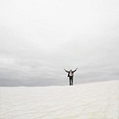 Businessman in the desert with his arms outstretched, Lancelin, Australia