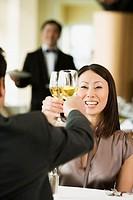 Asian woman toasting at restaurant