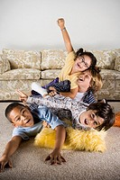 Group of children playing on the livingroom floor
