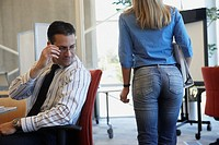 Businessman checking out female coworker