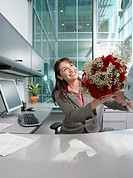 Hispanic businesswoman receiving flowers, Redwood City, California, United States