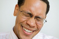 Close up of African American man smiling with eyes closed