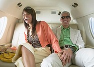 Couple sitting in private jet, Nobato, California, United States