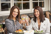 Two businesswomen toasting at lunch, Larkspur, California, United States
