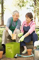 Senior Hispanic couple gardening