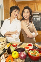 Asian mother and grown daughter preparing dinner, Freemont, California, United States