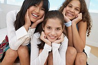Three teenaged girls smiling