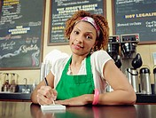 Waitress taking order in coffee shop