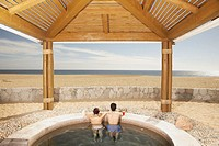 Couple in hot tub outdoors at beach resort, Los Cabos, Mexico