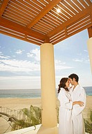 Couple hugging outdoors at a beach resort, Los Cabos, Mexico