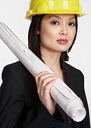 Studio shot of Asian businesswoman wearing a hard hat