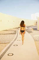 Woman in bathing suit outdoors at resort hotel, Los Cabos, Mexico