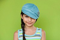 Studio shot of young Hispanic girl with hat