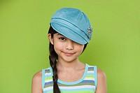 Studio shot of young Hispanic girl with hat