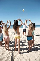 People on beach playing volleyball