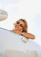 Mature woman in car, smiling, portrait