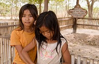 Children among the Killing Fields of Choeung Ek. Between 1975 and 1978 about 17,000 women, men, and children were transported to this extermination ca...