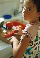 Girl cutting tomatoes