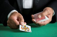Man dealing deck of cards, close-up