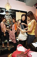 Women shopping in dress shop