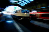 blurred view of a train pulling into a subway station